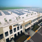 Large-Scale Solar Panels In Company Rooftop
